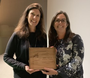 USGBC-MGC staff member Hope Gribble accepts the award from Lesli Moylan, Executive Director of Missouri Environmental Education Association at their annual conference.